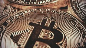 Crypto currency Gold Bitcoin - BTC - Bit Coin. Macro shots crypto currency Bitcoin coins rotating. Seamless looping. Cryptocurrency Gold Bitcoin - BTC - Bit stock footage