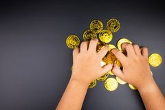 Cryptocurrency golden bitcoins coin in girl hand. Electronic vir Royalty Free Stock Image