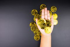 Cryptocurrency golden bitcoins coin in girl hand. Electronic vir Stock Photography