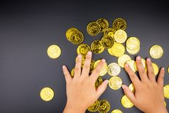 Cryptocurrency golden bitcoins coin in girl hand. Electronic vir Stock Images