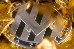 Cryptocurrency golden coins - Bitcoin, Ethereum, Litecoin on the background of gold nuggets. royalty free stock images