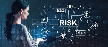 Cryptocurrency ICO risk theme with woman using a tablet royalty free stock photo