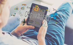 Cryptocurrency with man using a tablet. In a chair Royalty Free Stock Photos