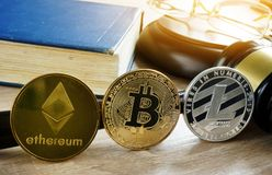 Cryptocurrency market regulation. Crypto coins and gavel on a desk. Cryptocurrency market regulation concept. Crypto coins and gavel on a desk royalty free stock photos