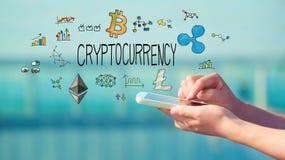 Cryptocurrency med smartphonen royaltyfria foton