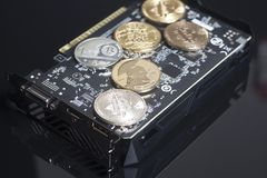 Cryptocurrency mining concept with bitcoins on a graphic videoca Royalty Free Stock Photos