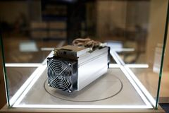 Cryptocurrency mining equipment - ASIC - application specific integrated circuit on farm stand at expo. Cryptocurrency mining equipment - ASIC - application Stock Photography