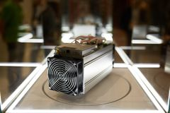 Cryptocurrency mining equipment - ASIC - application specific integrated circuit on farm stand at expo. Cryptocurrency mining equipment - ASIC - application Royalty Free Stock Photo