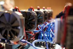Cryptocurrency mining equipment - lots of gpu cards on mainboard stock image