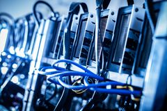 Cryptocurrency mining farm in a close-up shot. IT hardware. E-business stock photography