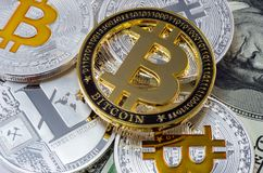 Cryptocurrency physical gold bitcoin coin on bitcoins and litecoin. New virtual money concept royalty free stock photos