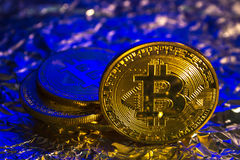 Cryptocurrency physical golden bitcoin coin on colorful background Royalty Free Stock Image