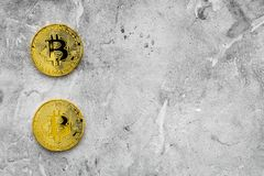 Cryptocurrency physical golden bitcoin coins for changing or selling stone background top view mock up. Cryptocurrency physical golden bitcoin coins for changing Royalty Free Stock Photos