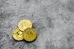 Cryptocurrency physical golden bitcoin coins for changing or selling stone background top view mock up. Cryptocurrency physical golden bitcoin coins for changing Stock Photography