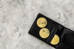 Cryptocurrency physical golden bitcoin coins for changing or selling stone background top view mock up. Cryptocurrency physical golden bitcoin coins for changing Royalty Free Stock Images