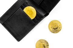Cryptocurrency physical golden bitcoin coins for changing or selling white background top view. Cryptocurrency physical golden bitcoin coins for changing or Royalty Free Stock Image
