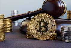Cryptocurrency regulation. Bitcoin and gavel on a desk. Cryptocurrency regulation concept. Bitcoin and gavel on a desk stock photo