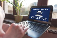 Cryptocurrency regulation concept on a laptop screen. Laptop screen displaying a cryptocurrency regulation concept royalty free stock image