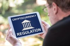 Cryptocurrency regulation concept on a tablet. Tablet screen displaying a cryptocurrency regulation concept royalty free stock photography