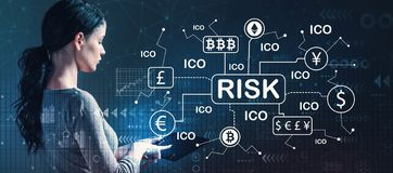 Cryptocurrency risk theme with woman using a tablet stock photos