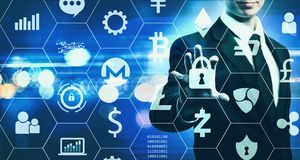 Cryptocurrency Security Theme with businessman on blue light bac. Cryptocurrency Security Theme with businessman on blurred blue light background Stock Photo