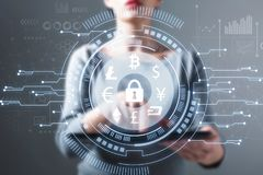 Cryptocurrency security theme with woman using a tablet stock photos