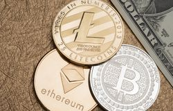 Cryptocurrency Silver and gold Bitcoin,litecoin,ethereum on doll Stock Image