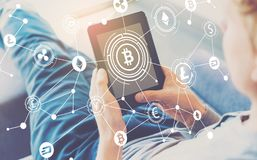 Cryptocurrency theme with man using a tablet royalty free stock image