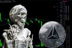 Cryptocurrency TRX νομισμάτων και skeletonon ένα διάγραμμα υποβάθρου ελεύθερη απεικόνιση δικαιώματος
