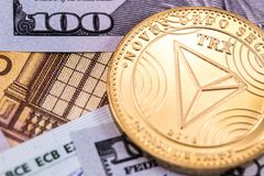 Cryptocurrency tron coin and money, dollars. Cryptocurrency trx tron coin and dollars, euro royalty free stock photos