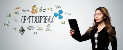 Cryptocurrency with woman holding a tablet computer. Cryptocurrency with businesswoman holding a tablet computer royalty free stock photos