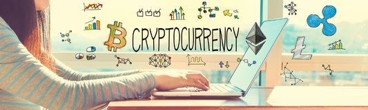 Cryptocurrency with woman working on a laptop. In brightly lit room royalty free stock photos