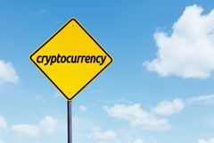 Cryptocurrency word on a yellow signpost. Picture of cryptocurrency word on a yellow signpost with  under blue sky Royalty Free Stock Photography