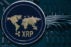 Cryptocurrency XRP da moeda no fundo dos fios e dos circuitos imagem de stock