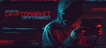 Cryptomarket concept with faceless hooded male person stock image