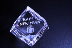 Crystal. A blue crystal engraved happy new year Stock Photo