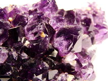 Crystal. The raw lilac sapphire on a white background stock photo