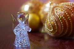 Crystal Angel on the background of Christmas balls. cristmas dec. Christmas balls on a wooden table.Crystal Angel on the background of  green Christmas balls,new Royalty Free Stock Photos