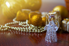 Crystal Angel on the background of Christmas balls. cristmas dec. Christmas balls on a wooden table.Crystal Angel on the background of  green Christmas balls,new Stock Photo