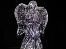 Crystal angel on dark background royalty free stock images