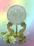 Crystal ball. Image and illustration still life composition of mystical crystal ball, brass stand with hydrangea flowers, floating bubbles, gold rose on soft Stock Photo