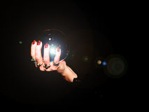 Crystal ball. A crystal ball is held in the hands of a fortune teller stock photography