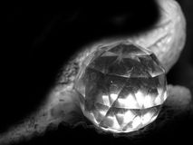 Crystal Ball. Close up of a crystal ball with interesting background stock photo
