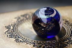 Crystal ball. Dark blue crystal ball on table stock photography