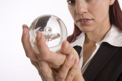 Crystal ball. Closeup of a woman hands holding a crystal ball with face slightly out of focus Royalty Free Stock Images