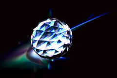 Crystal ball. Polished crystal with dark background, lights royalty free stock images