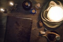 Crystal ball and ancient magic book with copy space. Seance. Future reading concept. Crystal ball and magic book with copy space on fortune teller magic desk Royalty Free Stock Photography