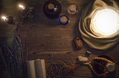 Crystal ball on magic table background with copy space. Seance. Future reading concept. Crystal ball and ancient magic scrolls on fortune teller magic desk Stock Image