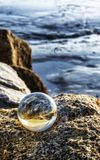 Crystal ball at beach. With reflection Royalty Free Stock Photography