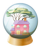A crystal ball with a beautiful house inside Stock Photo